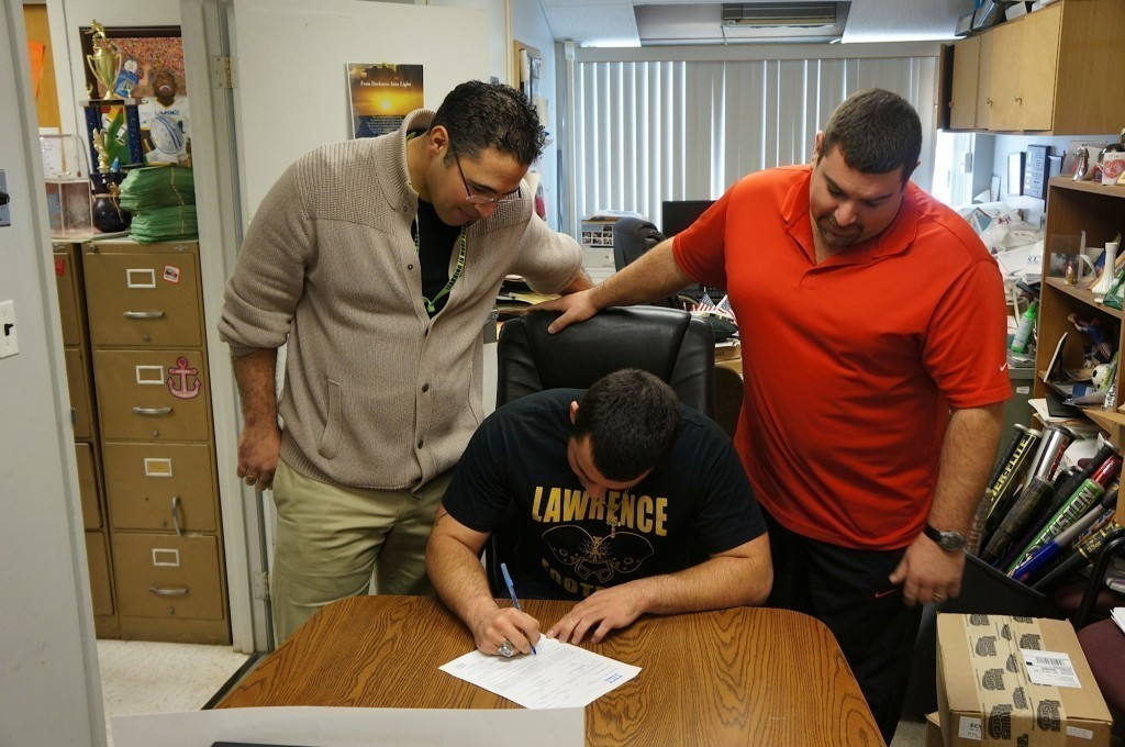 Lawrence senior Joe Capobianco, center, flanked by head coach Joe Martillotti, right, and assistant coach Frank Zangari, signed a letter of intent to Merrimack College.