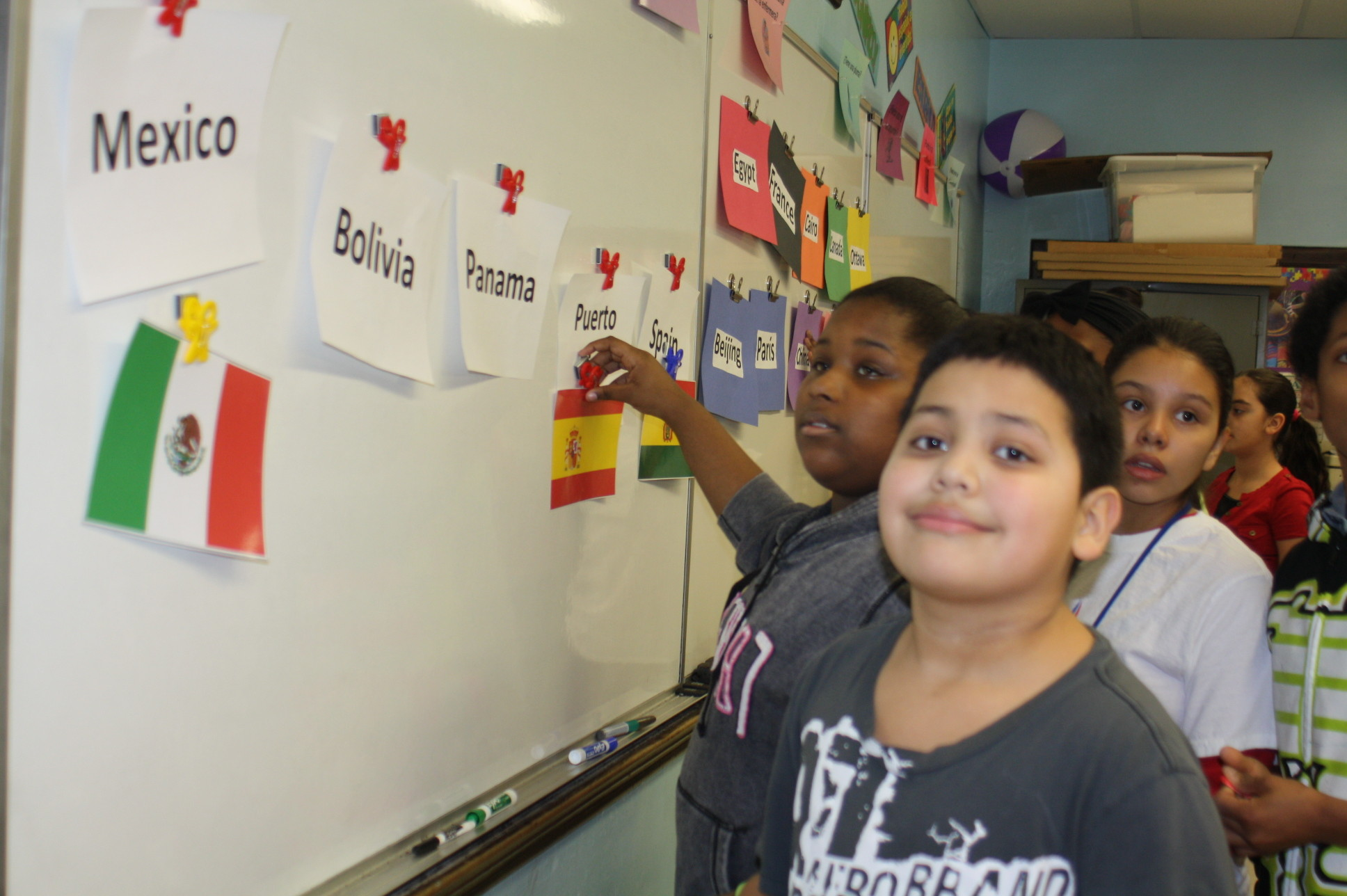 Students at Howard T. Herber Middle School in Malverne worked in teams during a foreign language-themed Olympic challenge to match countries with their flags.