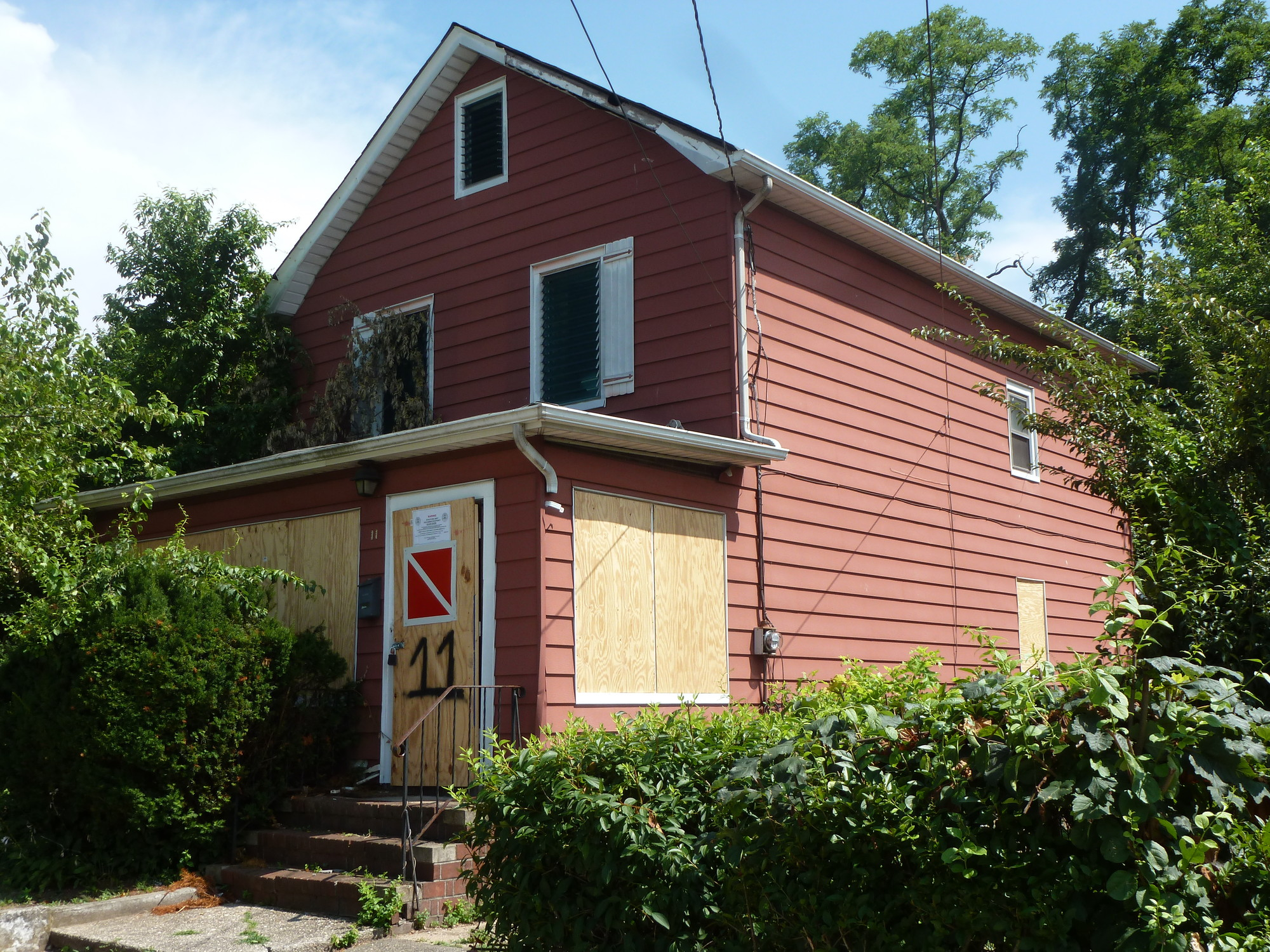 An abandoned house on Scaneateles Avenue in Lakeview � which was deemed �unfit for human occupancy� because of its overgrown shrubbery, mildew, animal feces and broken pipes � was where homeless teen Michael Ivey hid out before he was arrested on burglary charges.
