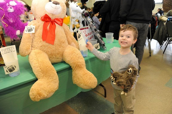 Tyler Grossman, 4, tried to win the biggest stuffed animal he could in the raffle.