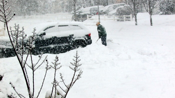 Residents shoveled as much as they could at the height of the morning snowstorm to get their vehicles out.