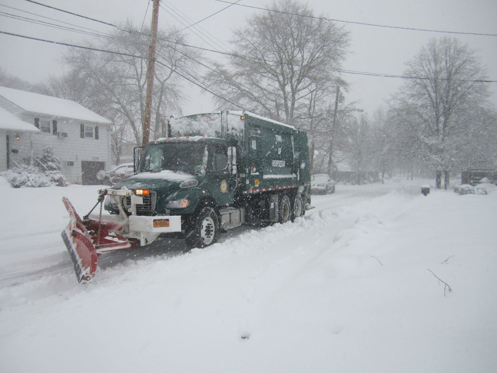 Town plowing crews are expected to work into the night Thursday, as officials said the latest winter storm is not expected to end until 5 a.m. on Friday.
