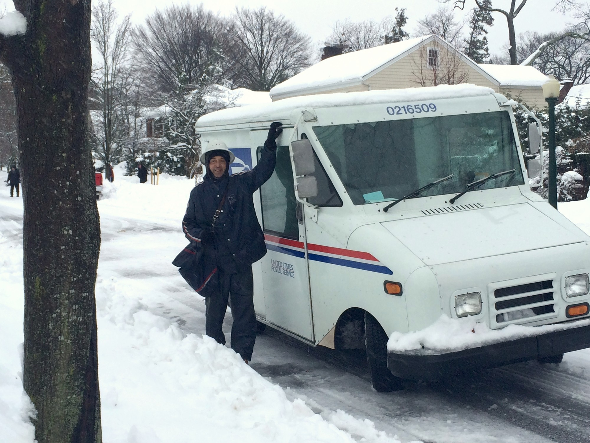 Neither snow nor rain nor heat nor gloom of night stays these couriers from the swift completion of their appointed rounds. This mailman in Rockville Centre braved the wintery weather to complete his rounds