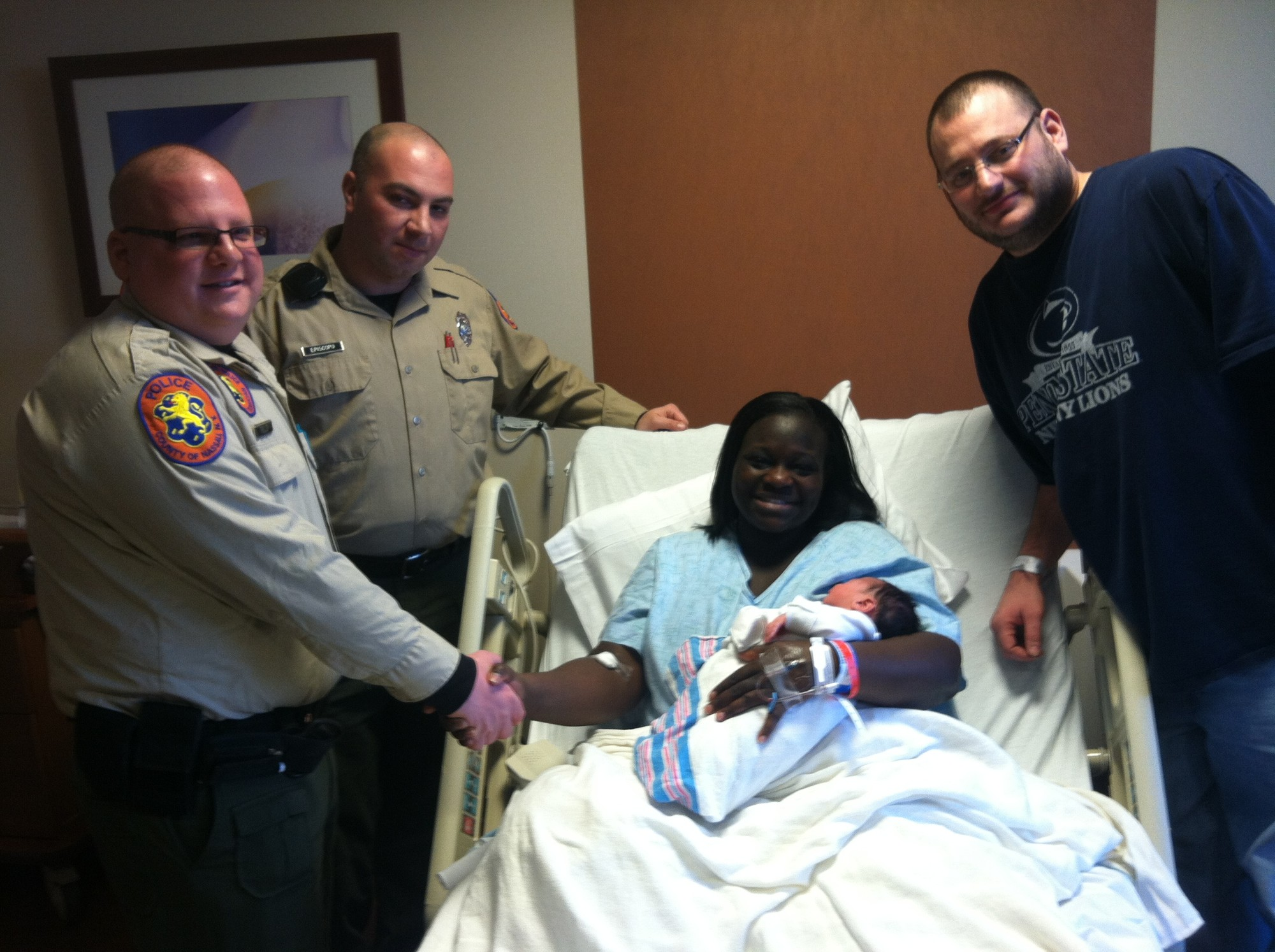 Regina and Andrew Jacoff thank EMTS Matthew Field and John Episcopo for helping to deliver their baby boy.