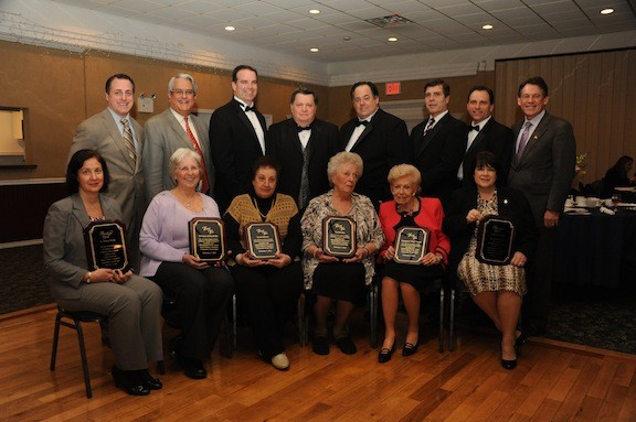 The awards winners proudly displayed their plaques. Seated from left were Dr. Melissa Burak, Eleanor deNeufville, Carol Burak, Flo Brooks , Margaret Smith and Linda Stephenson. Congratulating them were, standing from left, Assemblyman Brian Curran, Hempstead Town Councilman Anthony Santino, Lynbrook Village Trustee Tom Atkinson, Mayor Bill Hendrick, Trustee Mike Hawxhurst, Deputy Mayor Alan Beach, Trustee Hilary Becker, and Leg. Francis X. Becker.