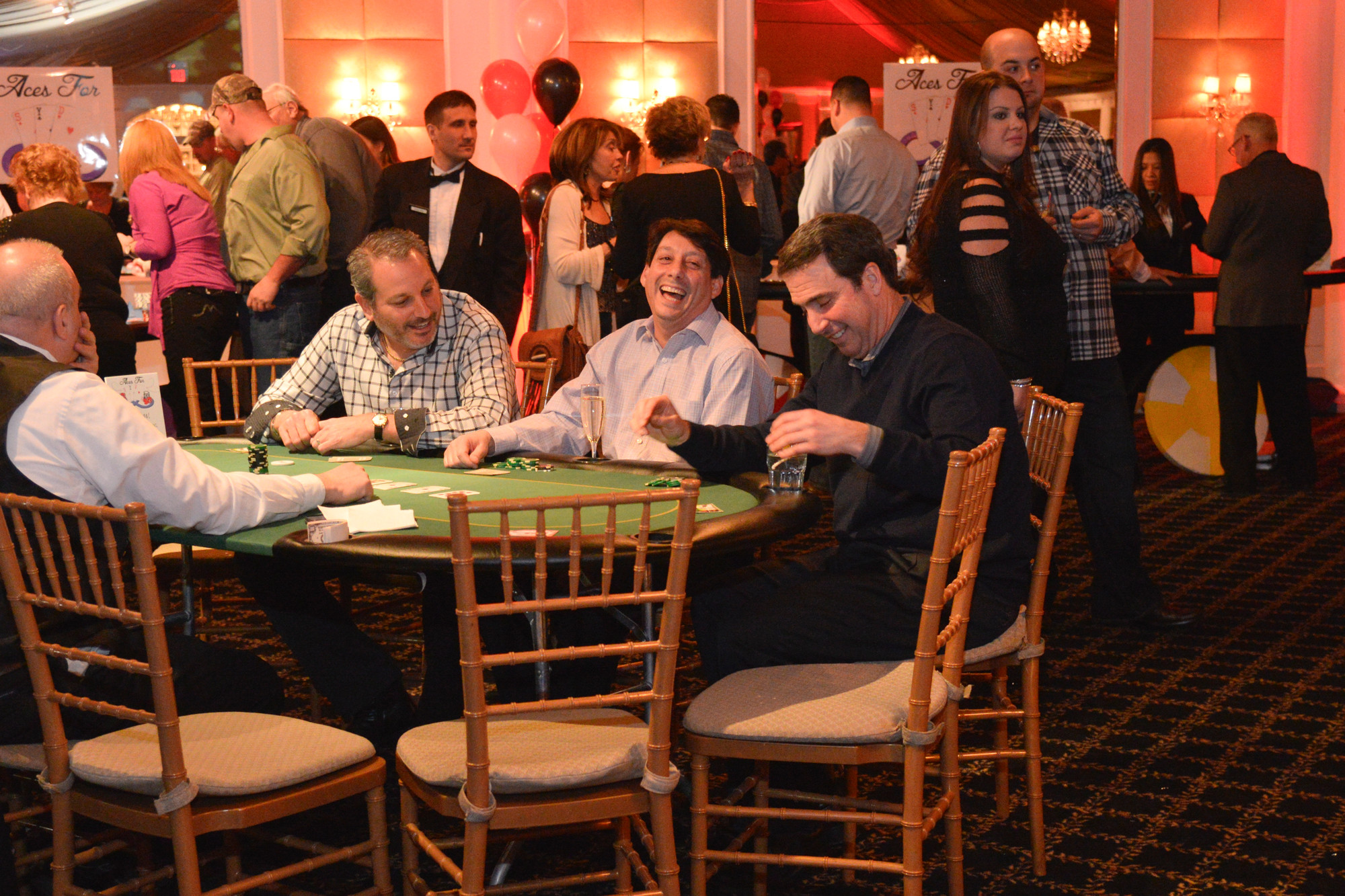 Lionel Goldberg, Jon Klee, Josh Deutsch enjoy black jack at the Sydne Jacoby Foundation Casino Night fundraiser held at Bridgeview in Island Park.