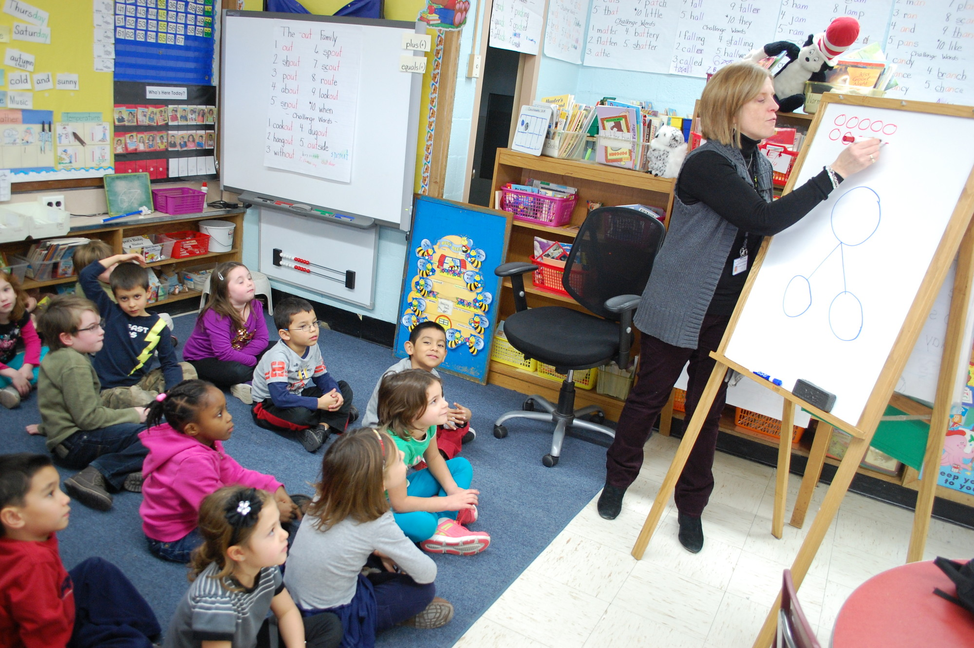 James A. Dever School first-grade teacher Debora O'Connor teachers a math lesson to her students. The District 13 Board of Education will be looking at ways to provide additional support in math for younger students.