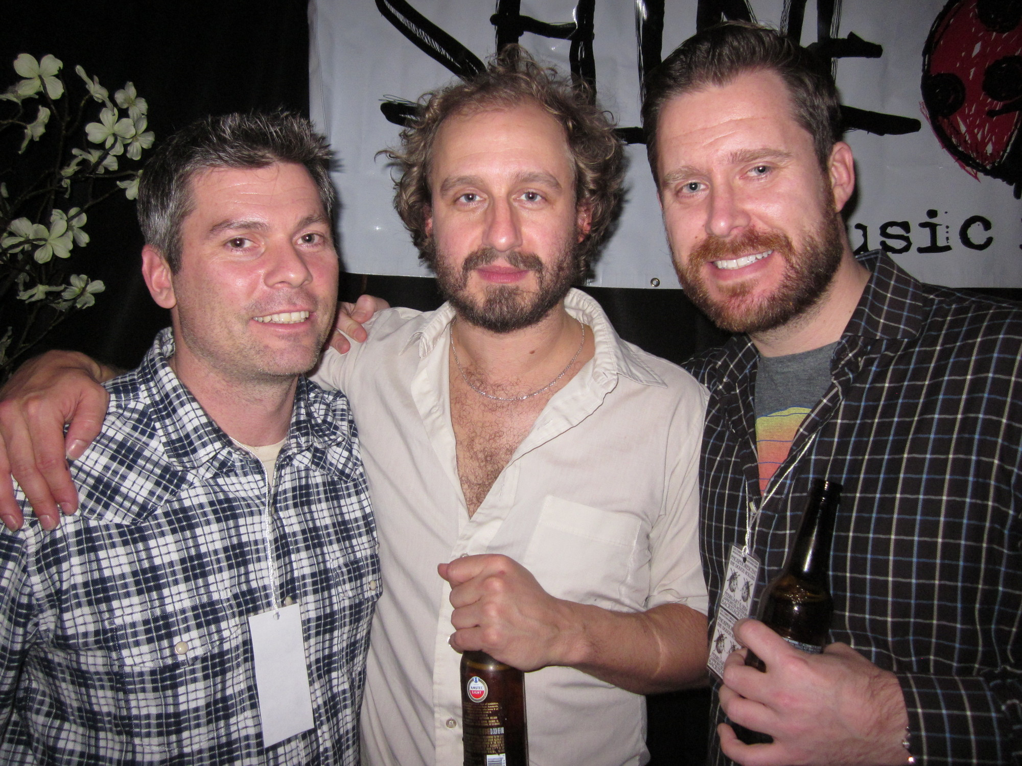 From left, Tommy Brull Foundation founder Martin Brull posed with Phosphorescent's Matthew Houck and fellow Brull Foundation volunteer Chuck Watson of Rockville Centre.