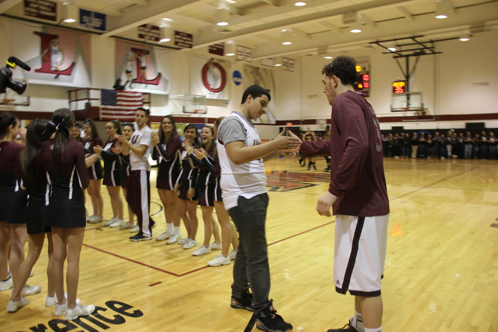 Alexander Perez, 14, left, was welcomed by Molloy basketball player Charlie Marquardt to the team. Molloy made Perez an honorary member of the team in conjunction with the Make-A-Wish Foundation.
