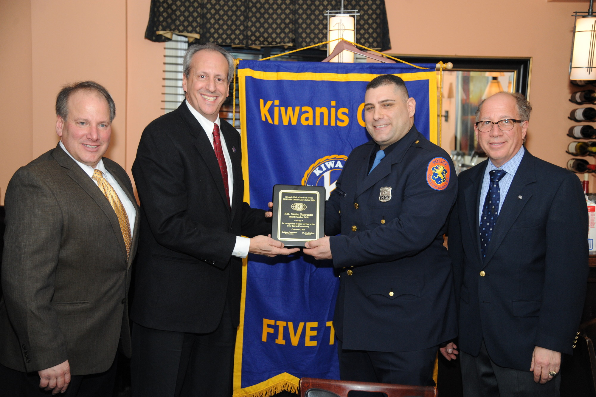 Kiwanis of the Five Towns members Anthony Campanile and Tom Cohen, Officer Santo Scavuzzo and Kiwanis President Dr. Fred Seltzer.