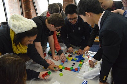 Lawrence Woodmere Academy is going to offer a new Global Curriculum Initiative beginning next fall. Students build a city with Legos at this year's global perspectives workshop.