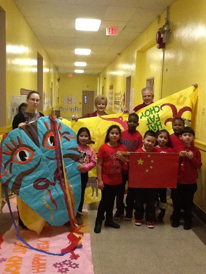 Second-graders at the Number Five School made dragons and paraded them around the building in celebration of Chinese New Year. From left in the back were student teacher April Acampora, second grade teacher Linda Soule and art teacher Dan Smalley. From left in front were students Anna Maria Perdomo, Jackie Portillo, Jaheim Nelson, Sean Varon, Johana Lopez, Stephene Blanchard and Jose Sequeira.