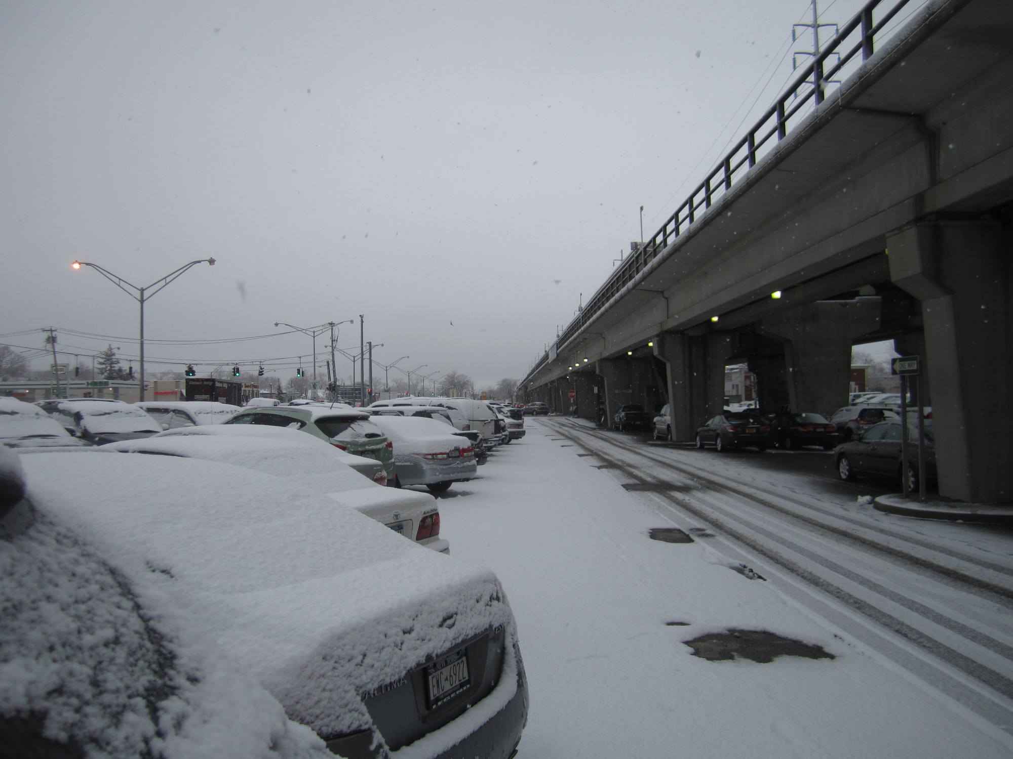 Despite the snow, the parking lots surrounding the Merrick LIRR station were, as usual, full on Tuesday morning.