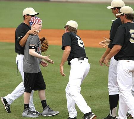 Nicholas Polo being congratulated by the University of Central Florida baseball team after throwing a perfect strike.