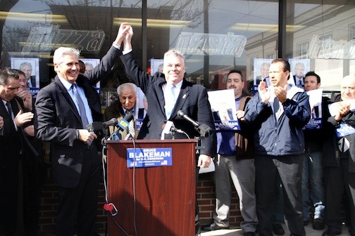 Rep. Peter King, right at the microphones, endorsed Bruce Blakeman, a former presiding officer of the Nassau County Legislature, in his bid for Congress. Also pictured are Cedarhurst Mayor Andrew Parise, between King and Blakeman, and Valley Stream Mayor Ed Fare, third from right.