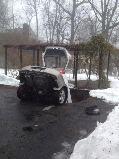 A collapsed cesspool swallowed a car on Driscoll Avenue in Rockville Centre Friday afternoon. The driver was unhurt.