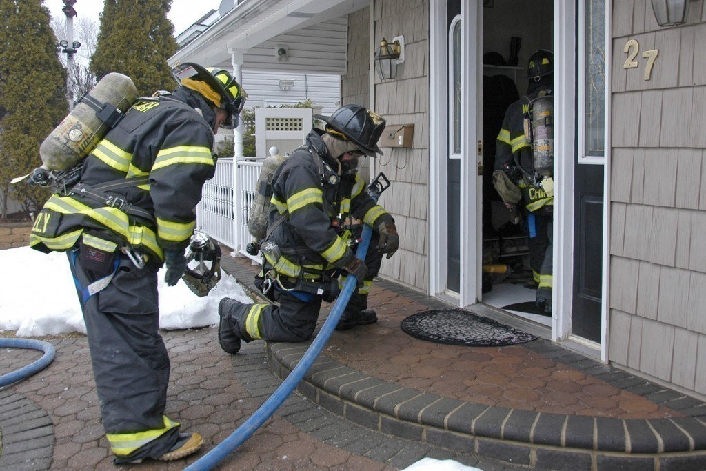 Wantagh firefighters enter the home on Vista Lane.