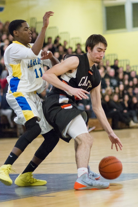 Carey's Kieran Murchie, right, who had 16 points, worked against Lawrence's Jymeek Jenkins during the Seahawks' Class A quarterfinal playoff win.