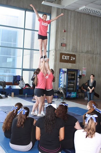 College of New Jersey cheerleaders demonstrated proper stunt techniques to Long Beach High School cheerleaders.