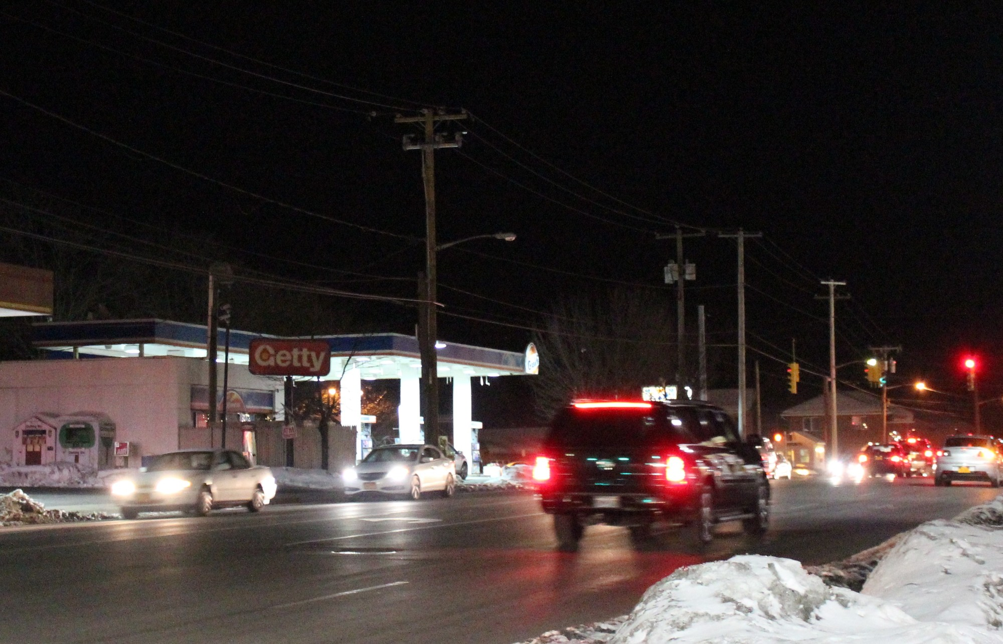 With streetlights out, vehicle headlights and gas station lights are the only illumination on Rockaway Turnpike in Cedarhurst.