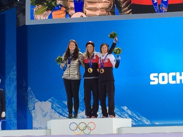 Devin Logan, left, with her silver medal, stands on the Medalist podium with Canadians Dara Howell, who took the gold, and Kim Lamarre, the bronze winner.