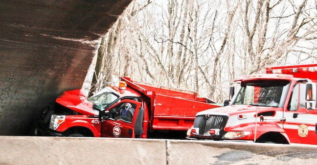 Truck crashes into the Meadowbrook Parkway overpass.