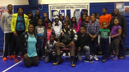 Tuskegee Airman Julius Freeman, center, spoke to kids at the MLK Center about his experiences as one of the U.S.'s first black fighter pilots.