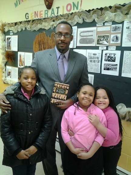 Ronnie Miles, center, taught children about W.E.B. DuBois.