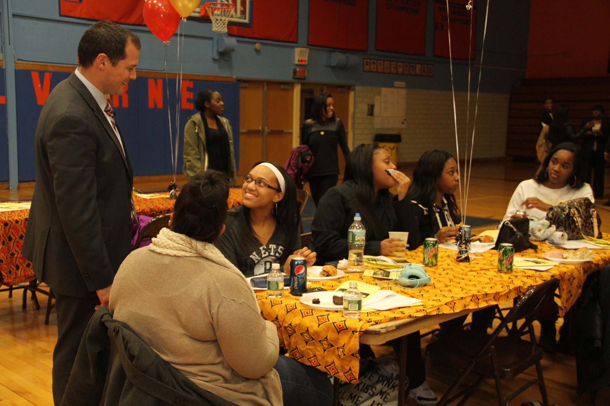 Principal Dr. Vincent Romano chatted with some Malverne High School students at this year's Black History Month celebration.