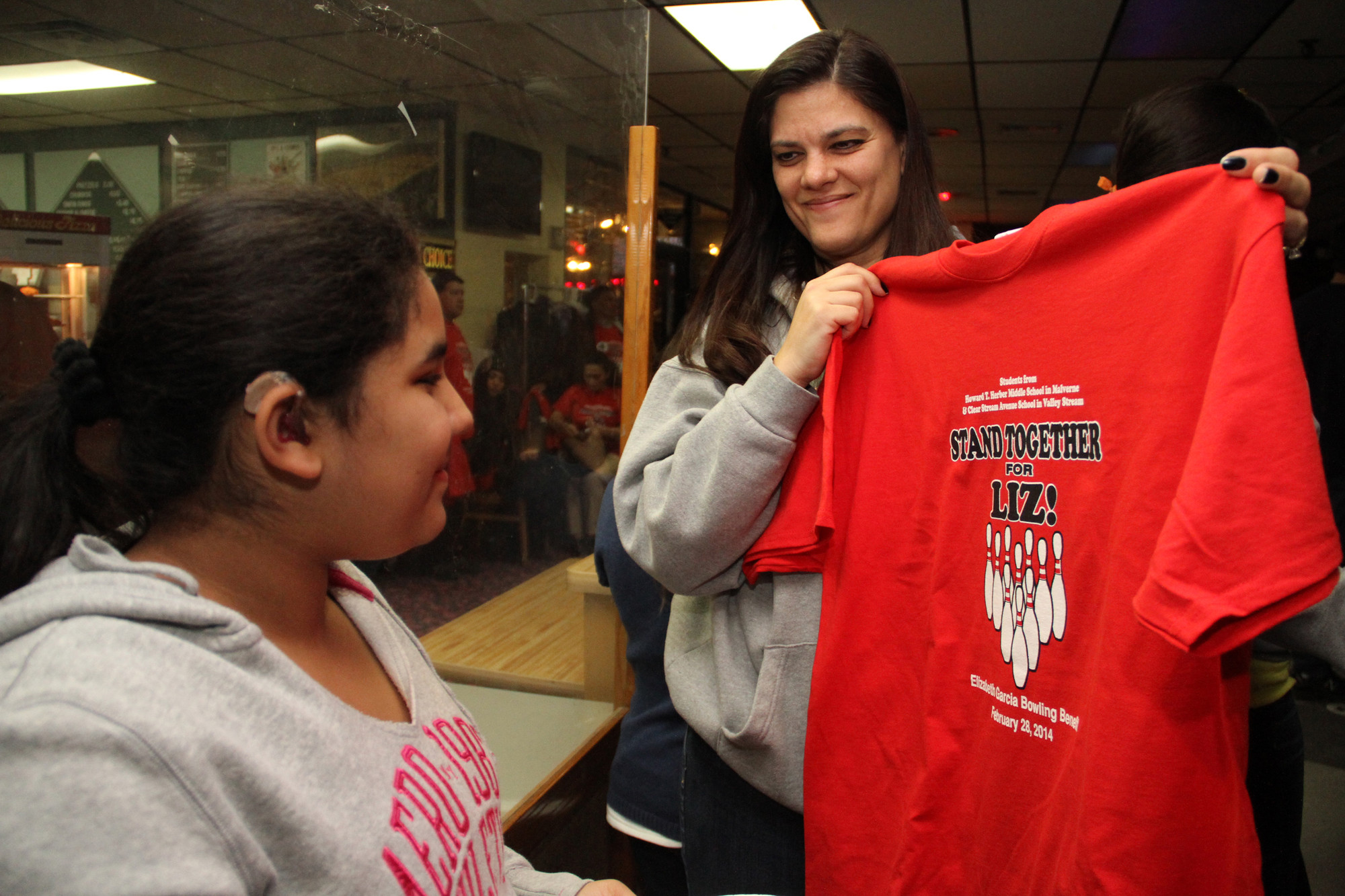 Jennifer Castellano showed Katherine Rodriguez a custom T-shirt made for the event, courtesy of the Howard T. Herber Middle School PTA.