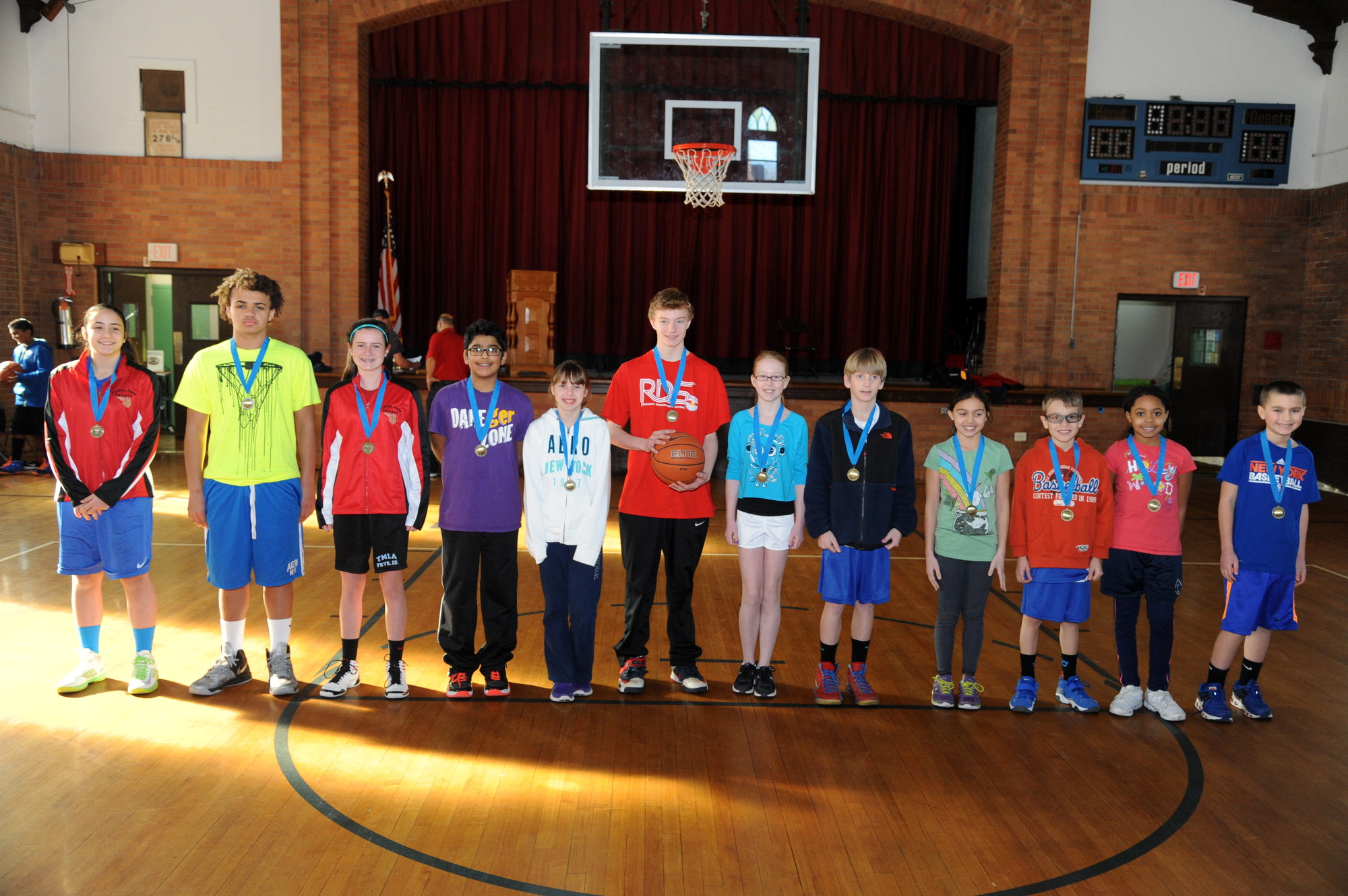 The winner in second second round of the Free-Throw Competition, from left, Danielle Devito, Tyler McCray, Maeve McGovern, Joel Thomas, Kate Grande, Bobby Bressmer, Rachel Wagner, Sean Colbert, Emily Saracino, Katherine Sinclair and Matthew Wallach.