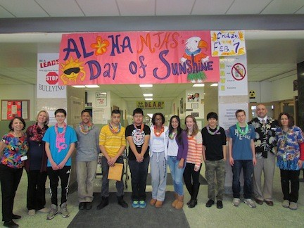 A Day of Sunshine, hosted by the BRAVE Committee earlier this month, was a day to build school spirit at Memorial Junior High School. From left are social worker Maggie McConnell, English teacher Kristine Edgar, students Kyle Bonilla, Otis Adames, Jaime Quiroz, Utsab Rai, Chelsea Davis, Sasha Mendoza, Natalie Zedzian, Brandon Aizcorbe and Kevin Aumuller, Principal Anthony Mignella and school nurse Connie Choinski.