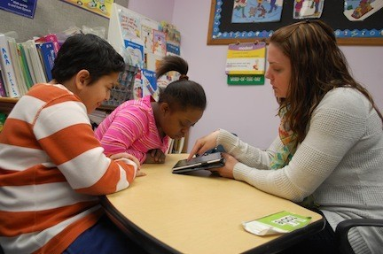 Forest Road School speech therapist Jennifer Kozub uses the iPad in working with fourth-grader Mobeen, and sixth-grader Nalyssa.
