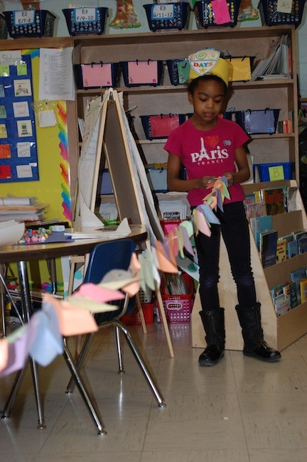 It took some time, she said, but Dever kindergartner Lily Francois made a long string with 100 paper hearts that stretched almost the entire width of her classroom.