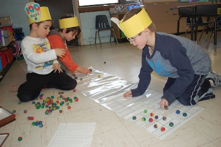 Dever kindergarten students counted out and sorted 100 of various objects, including clay balls.