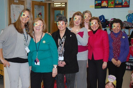"Dever kindergarten teaches and aides rocked their ""100"" glasses."