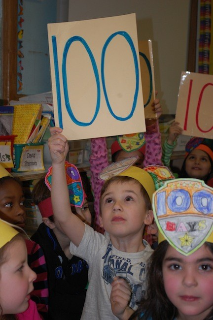 "Charles Dawe, a kindergarten student at the James A. Dever School, did his part as he and his classmates sang ""Have You Ever Seen 100?"""