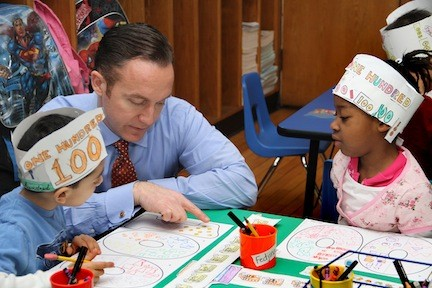 "Brooklyn Avenue School Principal Dr. Scott Comis looked over Thomas Gawargious and Fedjina ReJouis' ""100 Day"" project."