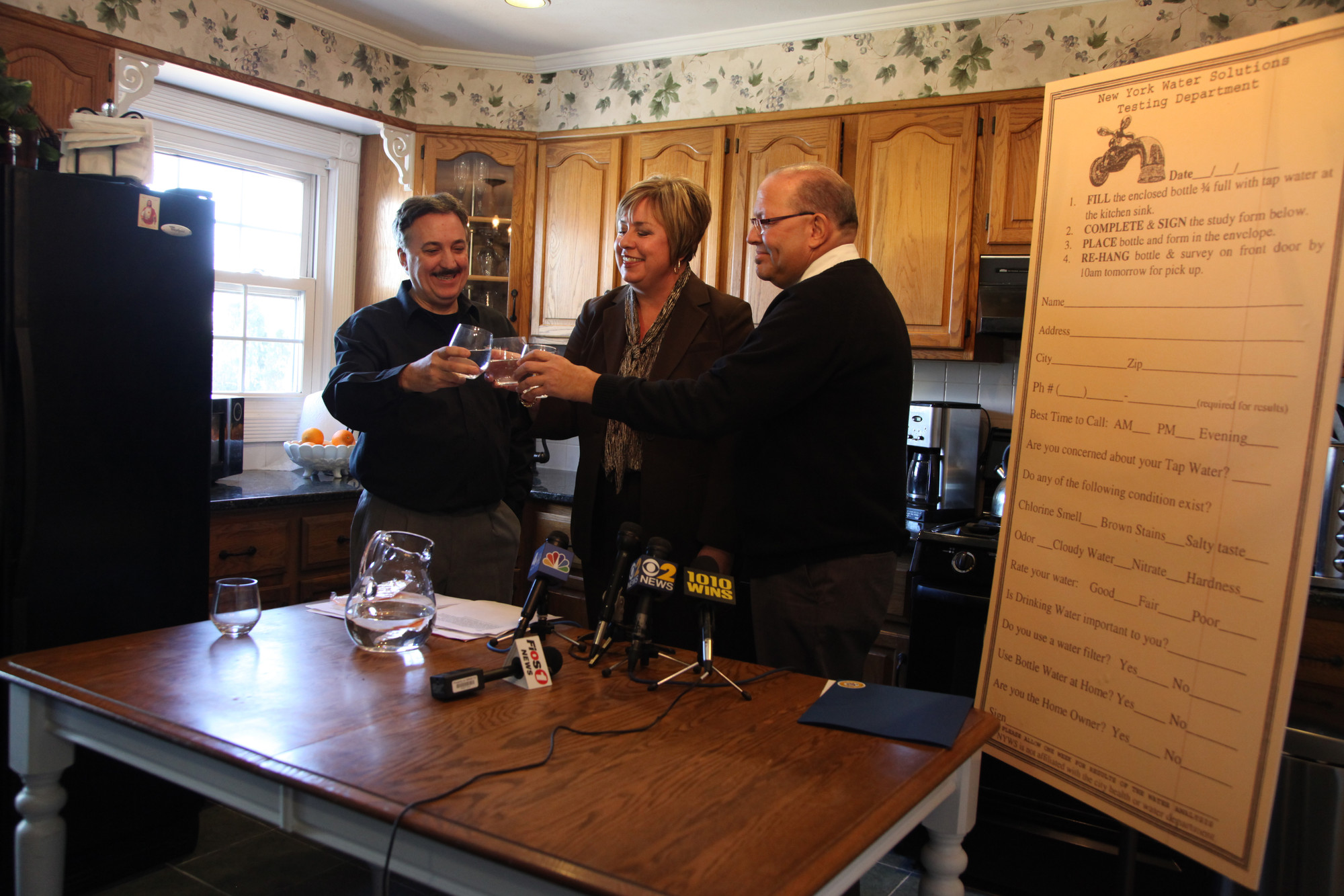 Borrelli's Italian restaurant owner Frank Borrelli, left, had a water toast inside his home with Town of Hempstead Supervisor Kate Murray and Councilman Gary Hudes to signify that the town's drinking water is safe.