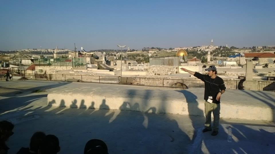 Our Israeli tour guide, Ayal Beer, led us through thousands of years of Israeli history. Here, he educated us on a rooftop in Jerusalem.