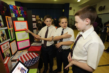 Theo Franks and Vincent O'Connell demonstrate to their good friend Patrick Burke their project on skin prick tests and their false/positive results on food allergies.