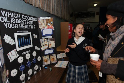 Gianna Labiento was excited to show her demonstration of  which cooking oil is the healthiest to Malverne resident Yanick Lapommeray.
