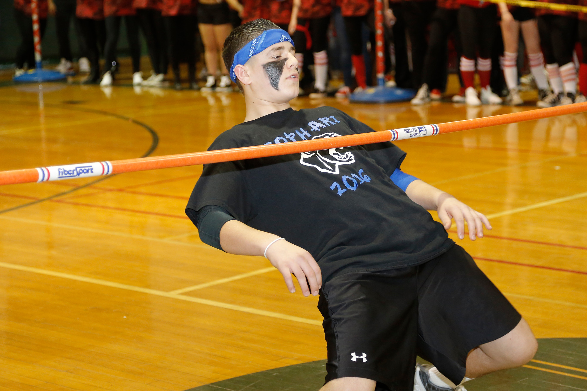 Sophomore Nino Rocalbuto shimmied under the limbo bar.