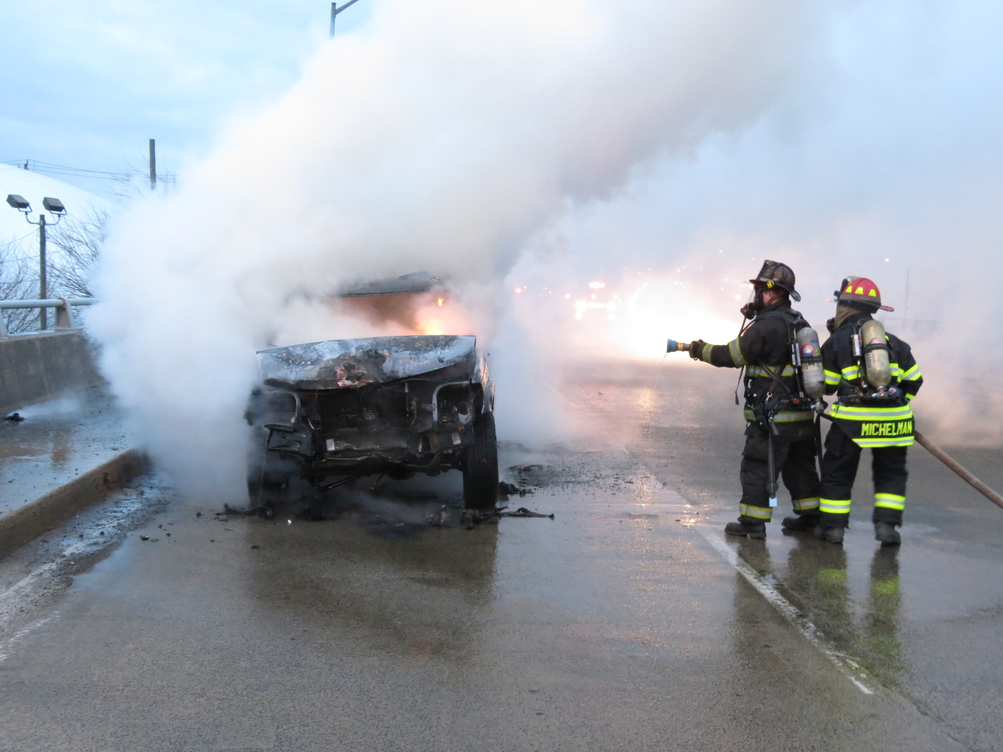Island Park firefighters responded to the scene of a car fire on the Long Beach Bridge on Friday morning.