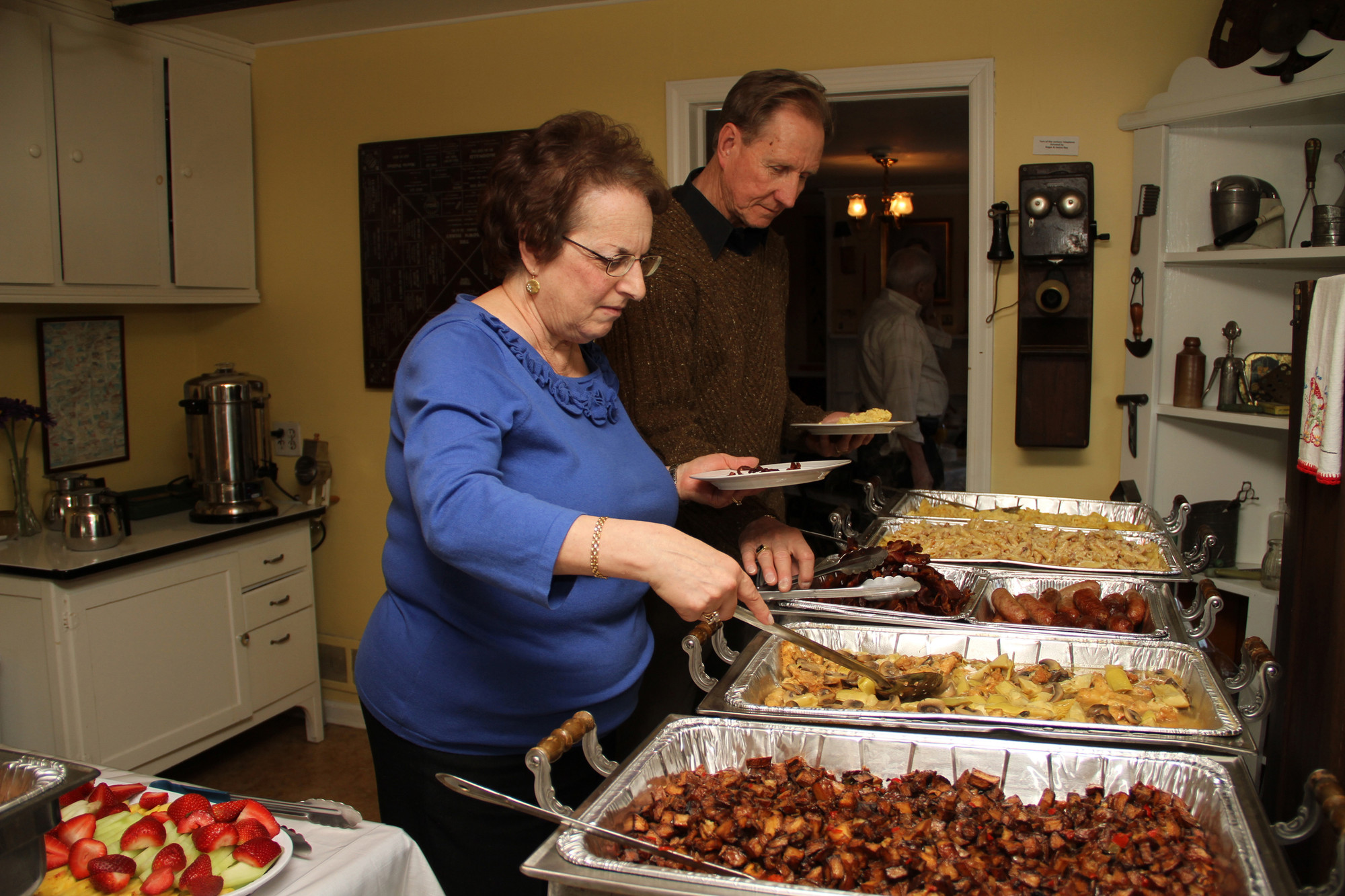 Anita and John Jurgielski worked their way down the buffet line at this year�s brunch.