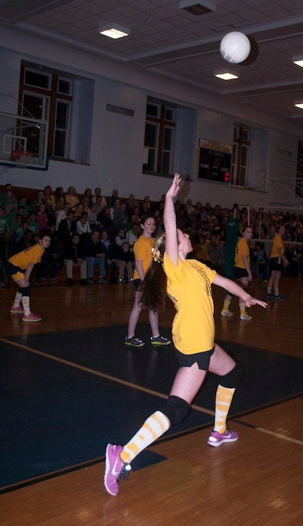 Stephanie Jackson of the Gold Team set up a serve during the girls volleyball.