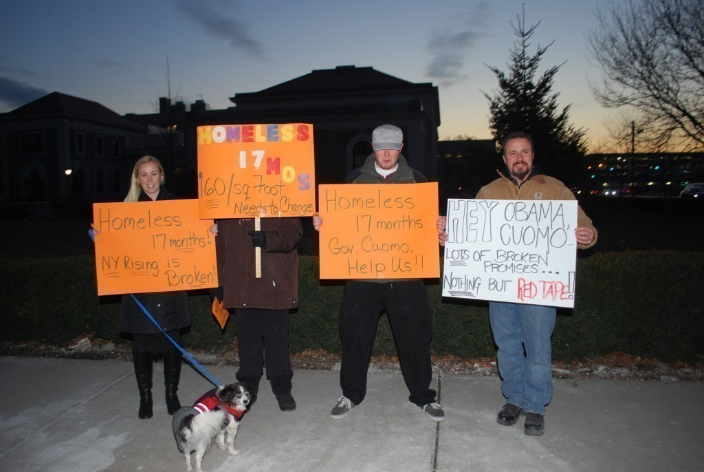 Patricia Dougherty, left, with her mother, Cathy, brother, Patrick, and Robert Wright, all Island Park residents, rallied outside the Theodore Roosevelt Executive and Legislative Building last week.