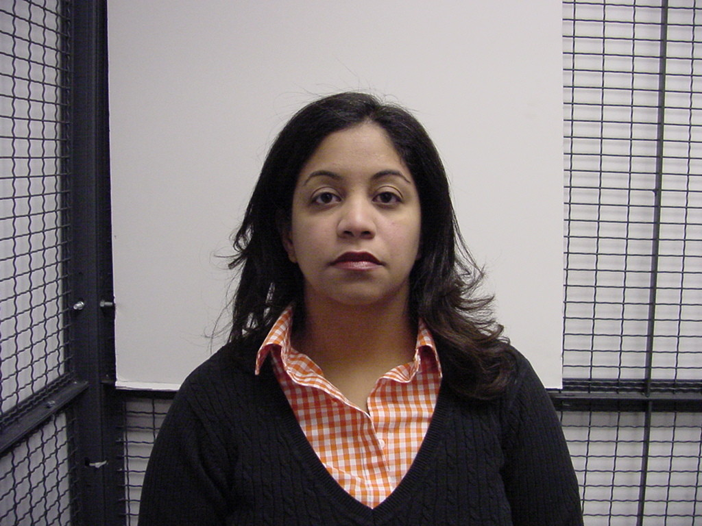 Urena De Checo is accused by the Nassau D.A. of stealing from her legal clients.