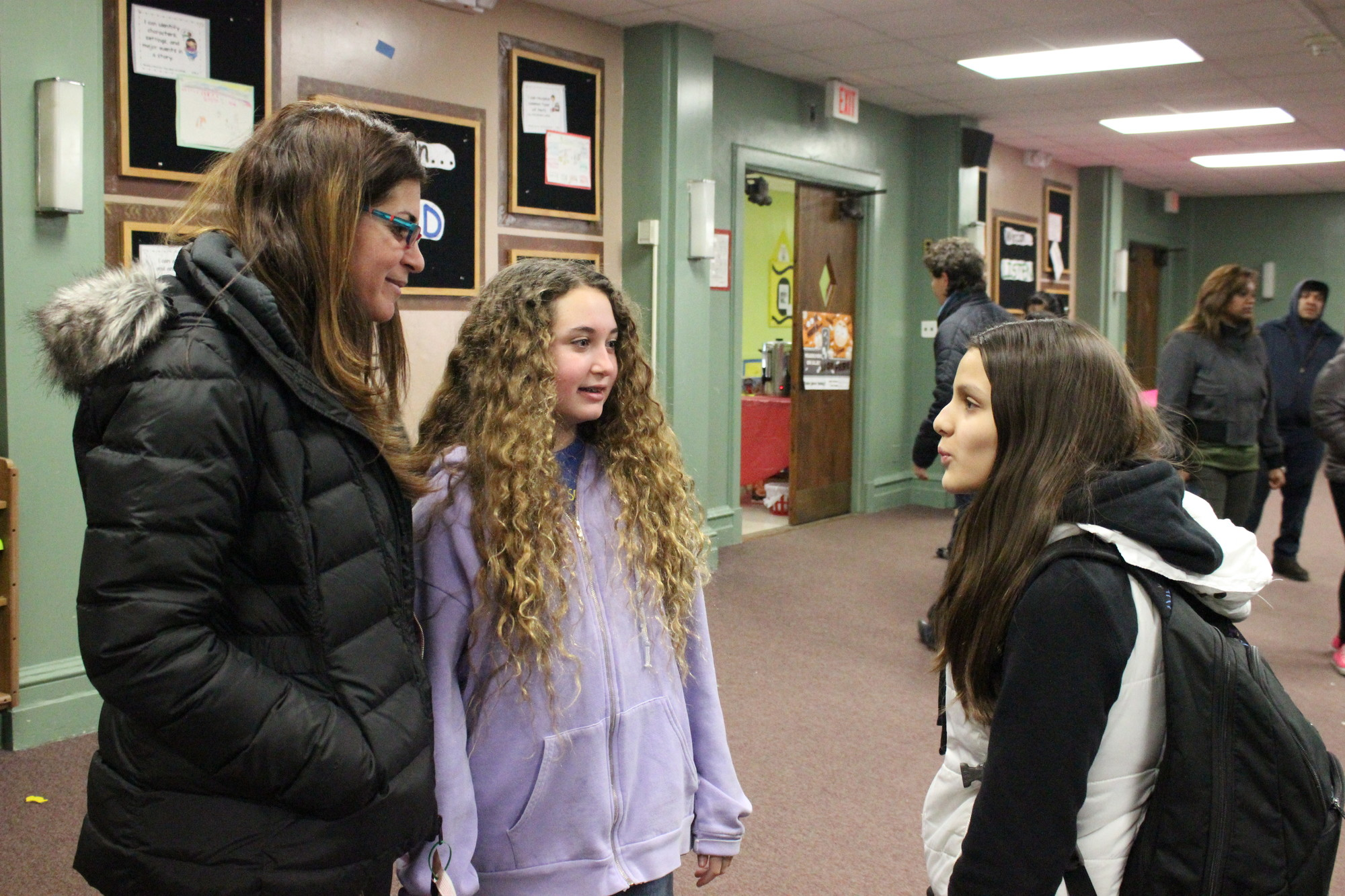 Lawrence Middle School was evacuated due to a gas leak on March 13. Ilene Parnes picked up her daughter Lucy, center, at the number Four School, as Melina Metopolis wanted for her parents.