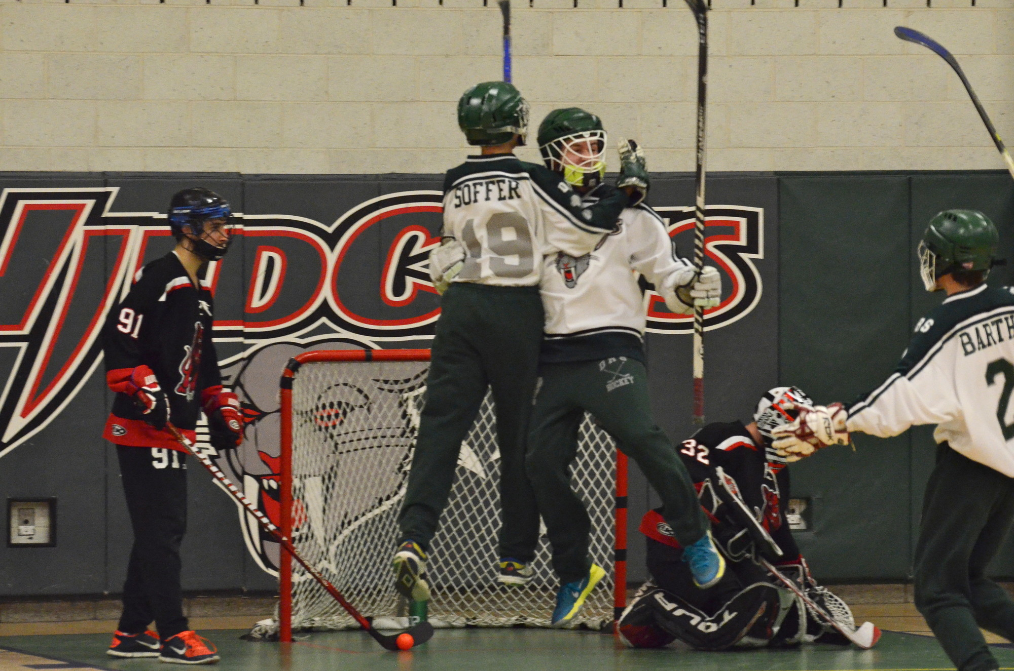 The DRS Wildcats floor hockey team advanced to the league finals. David Soffer (19) celebrated one of his team's eight goals with Avi Genachowski.